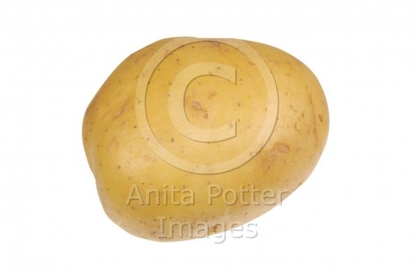 A Golden Potato Isolated on White
