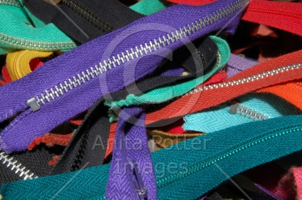 Close-up View of a Pile of Zippers